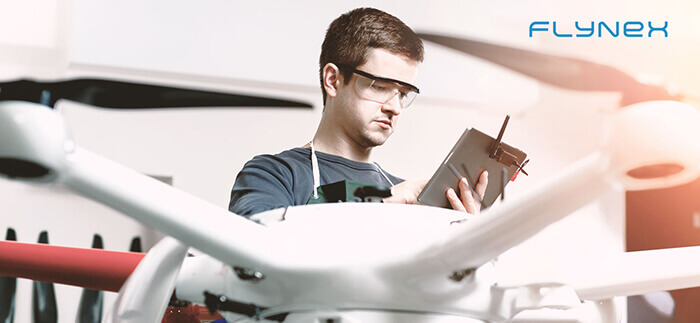Man with controller and drone