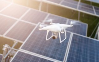 Drones flying over solar cells.Survey concept